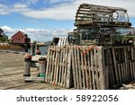 Lobster traps stored on wharf of Peggy's Cove fishing village in Nova Scotia - stock photo