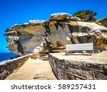 empty bench with rock... | Shutterstock . vector #589257431