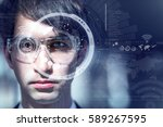 young man wearing smart glasses ... | Shutterstock . vector #589267595