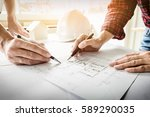 architects engineer discussing... | Shutterstock . vector #589290035