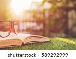 close up glasses and book on... | Shutterstock . vector #589292999