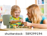 woman and child boy talking and ... | Shutterstock . vector #589299194