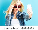 young woman taking a selfie on... | Shutterstock . vector #589353959