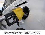 car refueling on a petrol... | Shutterstock . vector #589369199