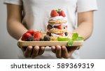 beautiful women hold a mix... | Shutterstock . vector #589369319
