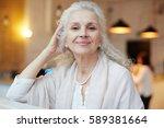 serene grandmother looking at... | Shutterstock . vector #589381664