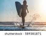 young woman runs with surfboard ... | Shutterstock . vector #589381871