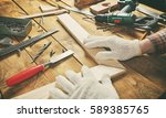 the carpenter works with wood... | Shutterstock . vector #589385765