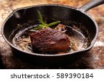 Small photo of Beef steak on cast iron skillet with empty space for text