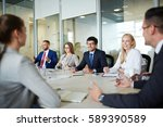 team of managers discussing... | Shutterstock . vector #589390589