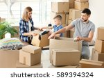 happy family packing boxes in... | Shutterstock . vector #589394324