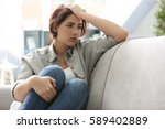 depressed young woman sitting... | Shutterstock . vector #589402889