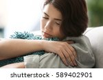 depressed young woman sitting... | Shutterstock . vector #589402901