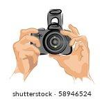 camera in hands vector | Shutterstock .eps vector #58946524