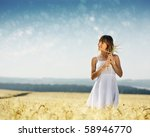 Young Smiling Woman In White...