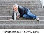 senior woman accidentaly... | Shutterstock . vector #589471841