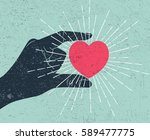hand holding heart symbol with... | Shutterstock . vector #589477775