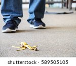 Small photo of Man about to step on a banana peel -- accidental injury concept