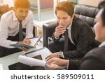 three business people serious... | Shutterstock . vector #589509011