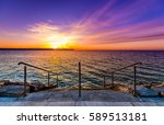 steps on a beach with sunset on ... | Shutterstock . vector #589513181