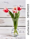Small photo of Glass vase with spring flowers. How to beautify your house.