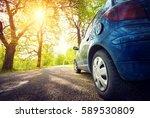car on asphalt road on spring...   Shutterstock . vector #589530809