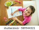 cute little girl  drawing... | Shutterstock . vector #589544321