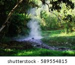 Small photo of Steam from Pong Duad Hot Spring is the Geyser type with green forest, Chiang Mai City, Thailand