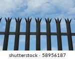 A Spiked Fence Against A Cloud...
