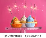 cupcakes with sparklers on... | Shutterstock . vector #589603445