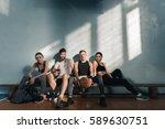 serious sporty men and women... | Shutterstock . vector #589630751