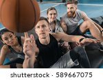 sporty young people looking at... | Shutterstock . vector #589667075