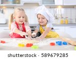 little kids making biscuits on... | Shutterstock . vector #589679285