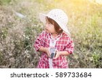 little girl photographs flower... | Shutterstock . vector #589733684