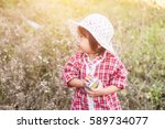 little girl photographs flower... | Shutterstock . vector #589734077