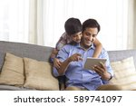 smiling father using digital... | Shutterstock . vector #589741097