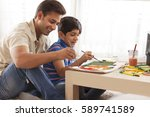 father and son painting with... | Shutterstock . vector #589741589