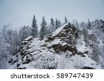 Rocks Winter Landscape. Ural...