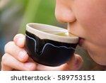 woman sipping tea. | Shutterstock . vector #589753151