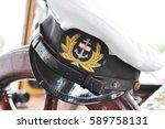 captain's hat on steering wheel.... | Shutterstock . vector #589758131