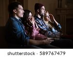 side view of scared friends... | Shutterstock . vector #589767479