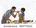 father and son cooking in... | Shutterstock . vector #589772651