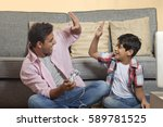father and son playing video... | Shutterstock . vector #589781525
