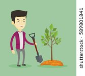 asian man plants a small tree.... | Shutterstock .eps vector #589801841
