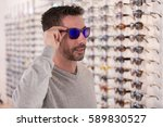 man wearing sunglasses in... | Shutterstock . vector #589830527