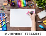 woman's hand drawing on empty... | Shutterstock . vector #589833869