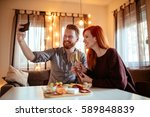 happy ginger couple enjoying...   Shutterstock . vector #589848839