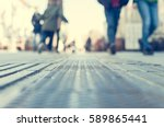 Small photo of People walking on the urban street in the city blurred image low point of view