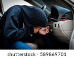 Thieves dressed Robber with Masks, Equipment Tamper keyway to connect the car Traction. Prior to steal cars and valuables of the victims.Thief Concept Photo. - stock photo