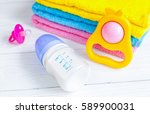baby bottle with milk and towel ... | Shutterstock . vector #589900031